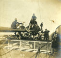 Army Troops Resting on a Mast